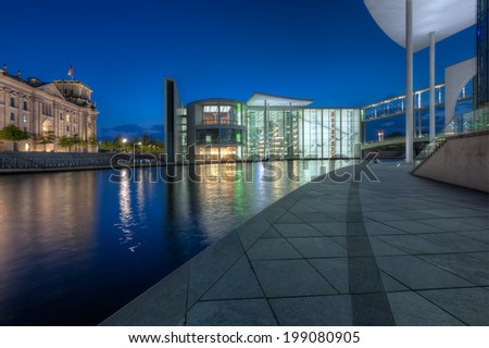 BERLIN, GERMANY - MAY 6 2014: The Paul-Loebe-Haus from the Marie-Elisabeth-Lueders-Haus and the Bundestag across the River Spree in Berlin., taken in May 6 2014. - stock photo