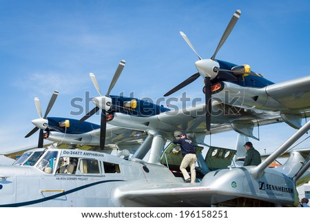 BERLIN, GERMANY - MAY 21, 2014: Turboprop engine Pratt & Whitney Canada PT6A-45, close-up. Flying boat Dornier Do 24ATT Amphibian (modern replica). Exhibition ILA Berlin Air Show 2014