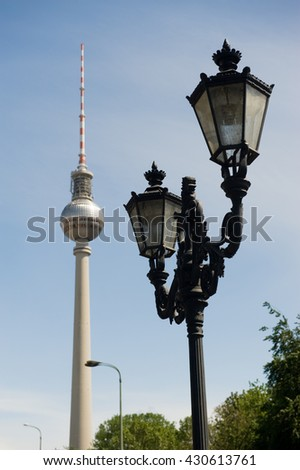 Berlin, Germany- May 15, 2016: View on  television tower in central Berlin, Germany with typical old street-lamp in the foreground.