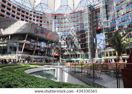 BERLIN, GERMANY - MAY 15, 2013: Visitors under the shade offered by the internal square of the Sony Center. The Sony Center is a sponsored modern commercial building complex located at Potsdamer Platz