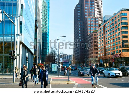 BERLIN, GERMANY - NOV 15, 2014: People crossing the street at Potsdamer Platz -  important public square and traffic intersection in the centre of Berlin, most bustling traffic intersection in Europe - stock photo