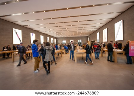 BERLIN, GERMANY - NOVEMBER 12, 2014: Buyers are shopping at Kurfuerstendamm Apple Store in Berlin, Germany on November 12, 2014.  - stock photo