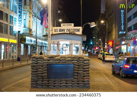 "BERLIN, GERMANY - NOVEMBER 16, 2014: Former bordercross checkpoint ""Point Charlie"" in Berlin. It's the best-known Berlin Wall crossing point between East and West Berlin during the Cold War."