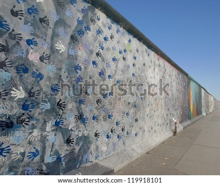 BERLIN,GERMANY- NOVEMBER 18: remains of 1.3 kilometers of the Berlin Wall has become the largest outdoor art gallery as the East Side Gallery restored on 2009 on18,2012 in Berlin-Germany - stock photo
