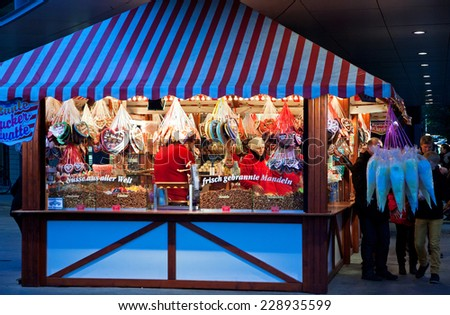 BERLIN, GERMANY - NOVEMBER 8, 2013: Sales of traditional Christmas sweets on the Christmas fair at Potsdamer Platz in Berlin - stock photo
