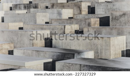 BERLIN, GERMANY - OCT 29, 2014: The Holocaust monument in Berlin, Germany. It consist of 2711 concrete blocks whit different highs and parallel alignment. - stock photo