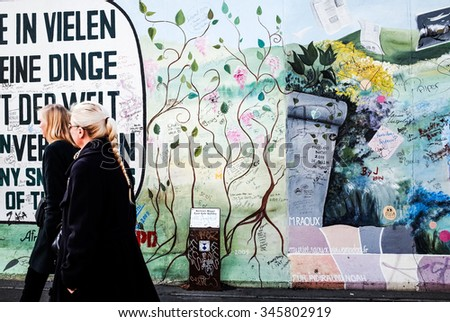 BERLIN, GERMANY- October 15, 2014: Berlin Wall was a barrier constructed starting on 13 August 1961. East Side Gallery is an international memorial for freedom. October 15, 2014 in Berlin  - stock photo