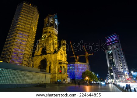 BERLIN, GERMANY - OCTOBER 17, 2014: The new Hilton Hotel (Zoofenster) and the Kaiser Wilhelm Memorial Church in the night lights. West Berlin