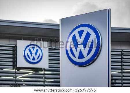 "BERLIN, GERMANY - OCTOBER 5: the VW logo of the brand ""Volkswagen"" at a car dealer building on Oct 5, 2015 in Berlin, Germany, Europe. Volkswagen AG is a German automotive manufacturing company. - stock photo"