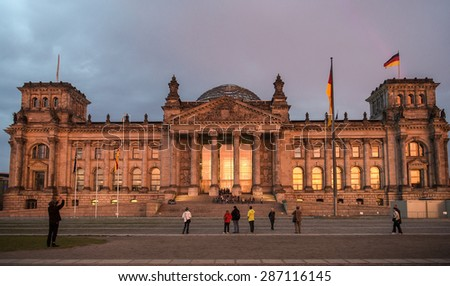 BERLIN, GERMANY -OCTOBER 13: Tourists walk around the Reichstag building, architect Paul Wallot in Berlin, Germany on october 13, 2014 It was opened in 1894 as a Parliament of the German Empire - stock photo