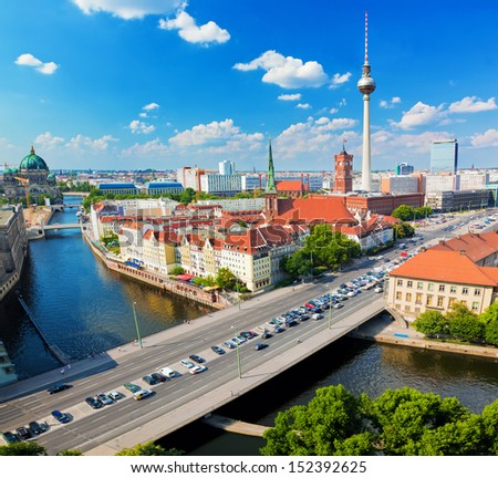 Berlin, Germany rooftop view on Television Tower, Berlin Cathedral, Rotes Rathau and the River Spree. Major landmarks under sunny blue sky - stock photo