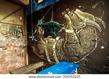 BERLIN, GERMANY - SEPT 2, 2015: Bound and hung goat , unknown artist graffiti in outdoor bar on Septemper 2, 2015. Urban area of Berlin comprised 4 million people, 7th most populous in EU