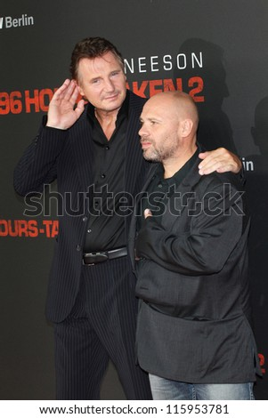 BERLIN, GERMANY - SEPTEMBER 11: Actor Liam Neeson and director Olivier Megaton attend the '96 Hours- Taken 2' Germany Premiere at Kino in der Kulturbrauerei on September 11, 2012 in Berlin, Germany. - stock photo