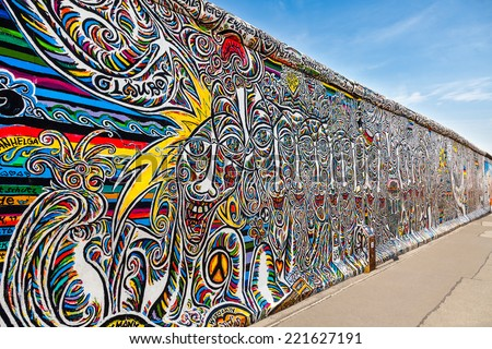 BERLIN, GERMANY - SEPTEMBER 15: Berlin Wall graffiti seen on SEPTEMBER 15, 2014, Berlin, East Side Gallery. It's a 1.3 km long part of original Berlin Wall which collapsed in 1989. - stock photo
