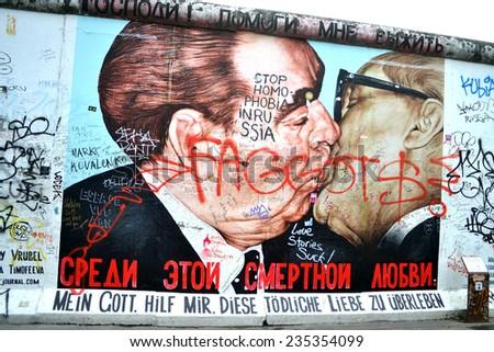 BERLIN, GERMANY - SEPTEMBER 14: Berlin Wall graffiti seen on SEPTEMBER 14, 2013, Berlin, East Side Gallery. It's a 1.3 km long part of original Berlin Wall which collapsed in 1989.    - stock photo