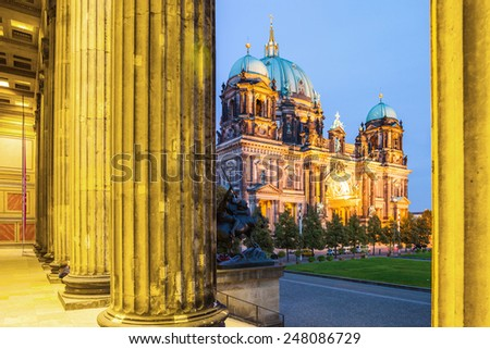 BERLIN - GERMANY- SEPTEMBER 30 :Highlighted building of Berlin Cathedral - Berliner Dom from the entrance of Altes Museum. Located at Museum Island in Berlin ; September 30, 2014 in Berlin, Germany - stock photo