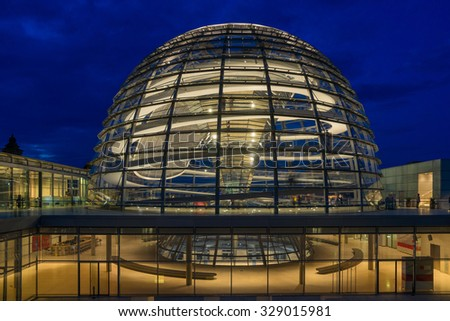 BERLIN, GERMANY, September 14. 2015; Illuminated glass dome on the roof of the Reichstag in Berlin in the  late evening.