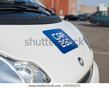 "BERLIN, GERMANY - SEPTEMBER 18: logo of the brand ""Car2Go"" on a smart for carsharing. Berlin, Germany, Europe sept 18 2014 - stock photo"