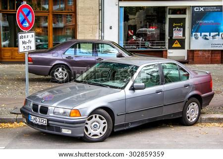 BERLIN, GERMANY - SEPTEMBER 10, 2013: Motor car BMW E36 3-series at the city street. - stock photo