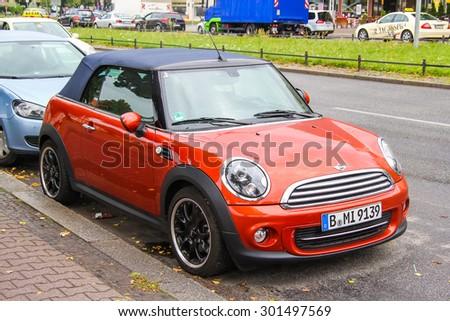 BERLIN, GERMANY - SEPTEMBER 10, 2013: Motor car Mini Cooper at the city street. - stock photo