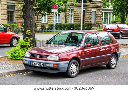 BERLIN, GERMANY - SEPTEMBER 10, 2013: Motor car Volkswagen Golf at the city street. - stock photo