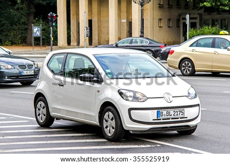 BERLIN, GERMANY - SEPTEMBER 10, 2013: Motor car Volkswagen Up! at the city street. - stock photo