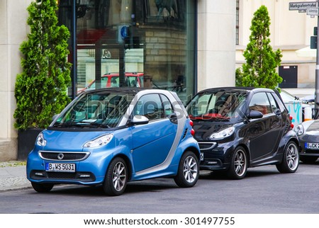 BERLIN, GERMANY - SEPTEMBER 12, 2013: Motor cars Smart Fortwo at the city street. - stock photo