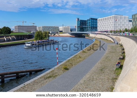 Berlin, Germany - September 19, 2015. The river Spree in the heart of Berlin, in the background the main train station, hotels and office buildings.