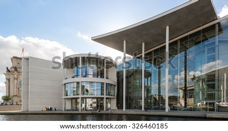 BERLIN, GERMANY - SEPTEMBER 27, 2015: View on the Reichstag and other government buildings along the so called Band des Bundes (Bond Of The Federal Government) in Berlin from the river Spree on a - stock photo