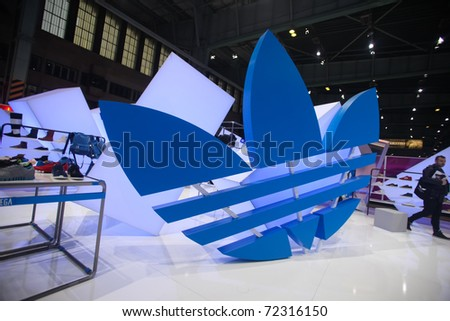 BERLIN - JANUARY 21:  Adidas stand at Bread & Butter fair on January 21, 2011 in Berlin, Germany. Tens of thousands of visitors attended the tradeshow this year. - stock photo