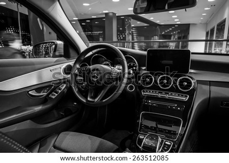 BERLIN - JANUARY 24, 2015: Showroom. Cabin of a compact executive car Mercedes-Benz C220 BT Limousine. Black and white. Produced since 2014. - stock photo