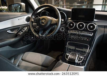 BERLIN - JANUARY 24, 2015: Showroom. Cabin of a compact executive car Mercedes-Benz C220 BT Limousine. Produced since 2014. - stock photo