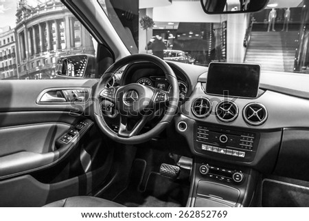 BERLIN - JANUARY 24, 2015: Showroom. Cabin of a compact luxury car Mercedes-Benz B-Class Electric Drive. Black and white. The first production car with an electric engine. Produced since 2014. - stock photo