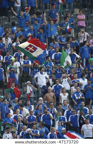BERLIN - JULY 9:  Italian supporters cheer prior to the start of the 2006 FIFA World Cup final between Italy and France July 9, 2006 in Berlin, Germany.