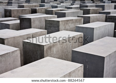 BERLIN - JULY 31: The Memorial to the Murdered Jews of Europe on July 31, 2009 in Berlin. The site measures 19,000 square metres and contains 2,711 concrete slabs. - stock photo
