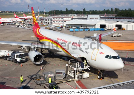 BERLIN - JUN 1: Airbus A330 from Hainan Airlines at the gate of Berlin-Tegel International Airport - stock photo