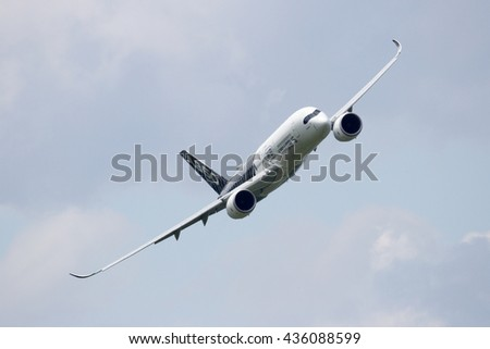 BERLIN - JUN 2, 2016: Airbus A350 XWB flyby after take off at Berlin-Schoneveld airport. - stock photo