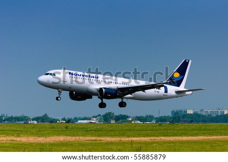 BERLIN - JUNE 11: Airbus A320-214 lands during ILA Berlin Air Show on June 11, 2010 in Berlin, Germany