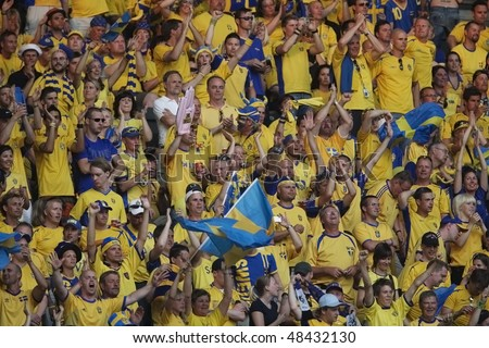 BERLIN - JUNE 15:  Sweden supporters cheer their team prior to a 2006 FIFA World Cup soccer between Paraguay and Sweden June 15, 2006 in Berlin, Germany. - stock photo
