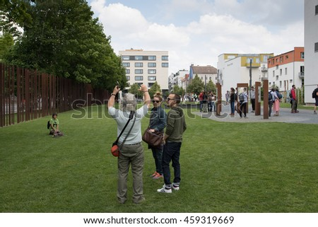 BERLIN - JUNE 19: Tourists at the Berlin Wall Memorial in Bernauer strasse on June 19, 2016 in Berlin, Germany.