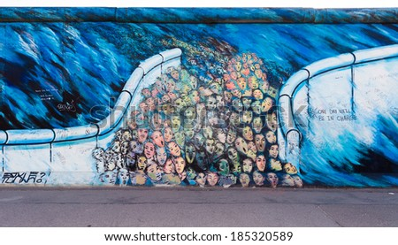 BERLIN - MARCH 30, 2014: East Side Gallery in Berlin contains artwork and graffiti and is an international memorial for freedom. The wall is 1.3km long. - stock photo