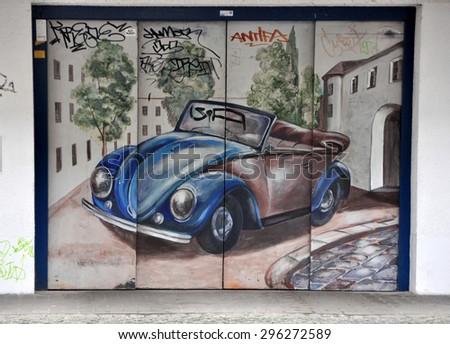 BERLIN, MARCH 6: Graffiti Garage in Easten Berlin (Berlin is the most popular city among graffiti artists) on March 6, 2015 in Berlin. - stock photo
