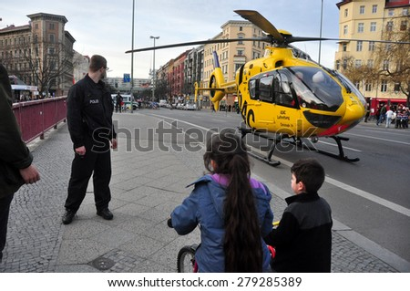 BERLIN - March 3: Police helicopter is landing on the road during knifing accident on March 3, 2015 in Berlin, Germany.