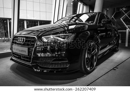 BERLIN - MARCH 08, 2015: Showroom. Compact executive car Audi A3 1.8 T quattro. Black and white. Audi A3 is a winner World Car of the Year 2014 - stock photo