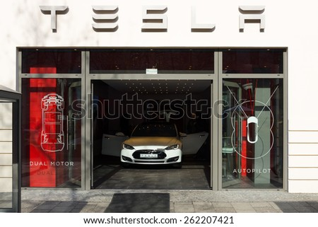BERLIN - MARCH 08, 2015: Showroom company of Tesla Motors on Kurfurstendamm. Tesla Motors, Inc. is an American company that designs, manufactures, and sells electric cars. - stock photo