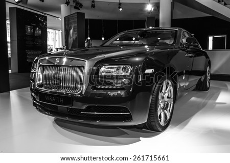 BERLIN - MARCH 08, 2015: Showroom. Full-size car Rolls-Royce Wraith (2013). Black and white. Rolls-Royce Motor Cars Limited global manufacturer of luxury cars. - stock photo