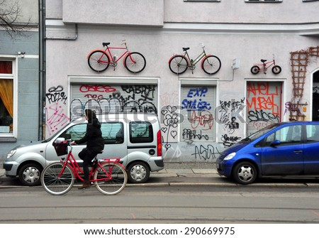 BERLIN MARCH 6: Unidentified female riding the bicycle (over 15% people in Berlin prefer moving by bike) on March 6, 2015. - stock photo