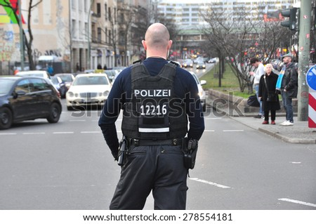 BERLIN - March 3: Unidentified policeman controls the situation during knifing accident on March 3,  2015 in Berlin, Germany.  - stock photo