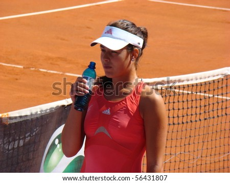 BERLIN - MAY 11:  Ana Ivanovic of Serbia having a drink before a match in the Berlin Open 2008 on May 11, 2008. - stock photo