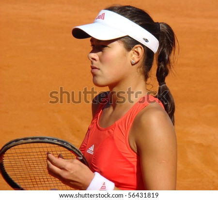 BERLIN - MAY 11:  Ana Ivanovic of Serbia inspects her racket during a match in the Berlin Open 2008 on May 11, 2008. - stock photo